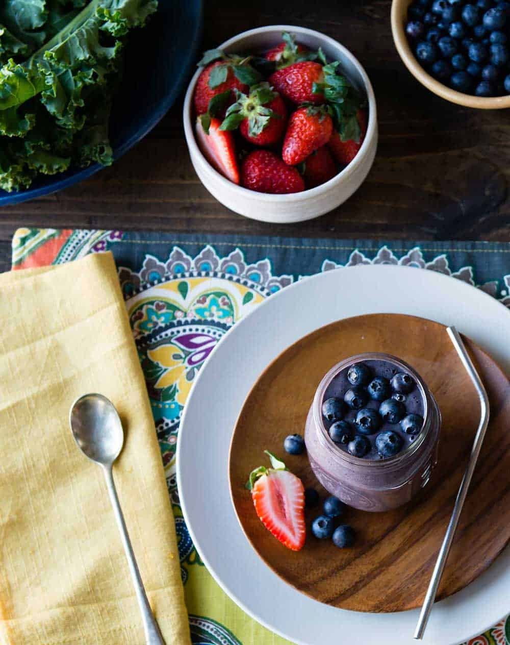 this beautiful berry smoothie topped with blueberries also makes the list of detox drinks for weight loss.