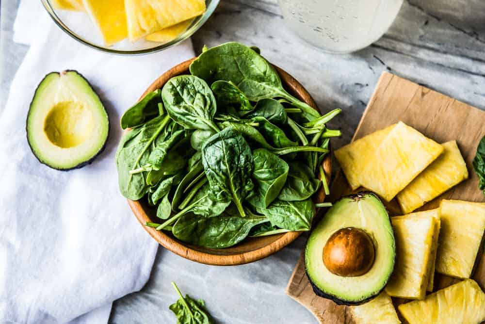 spinach, avocado, and pineapple are some of the best foods for clear skin