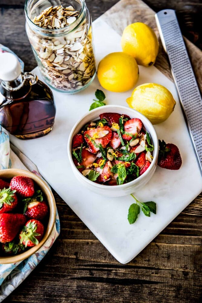 beautiful strawberries, lemon, maple syrup and mint form a delicious snack