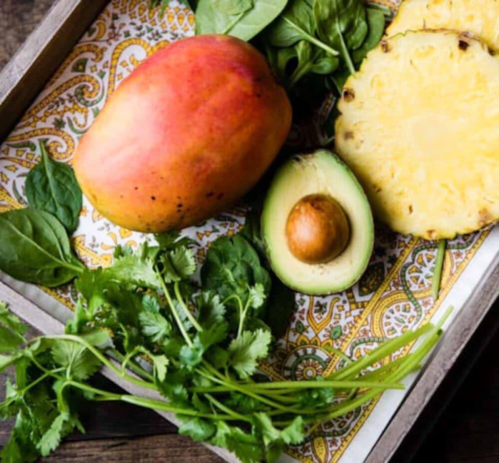 Cilantro, mango, avocado and fresh pineapple for green smoothie