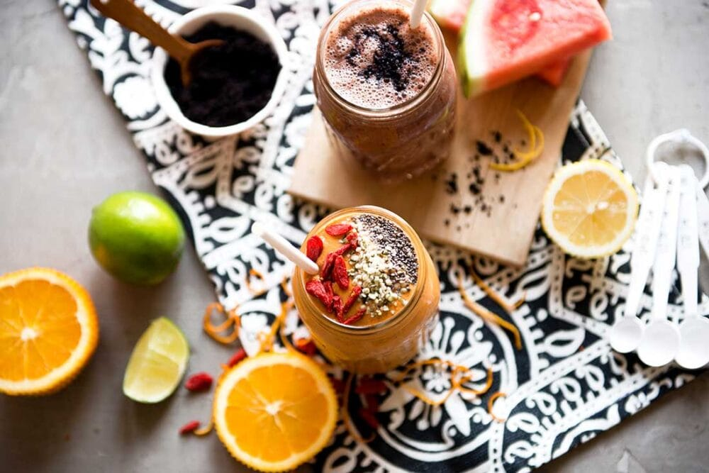 Superfood smoothie with oranges, goji berries and limes.