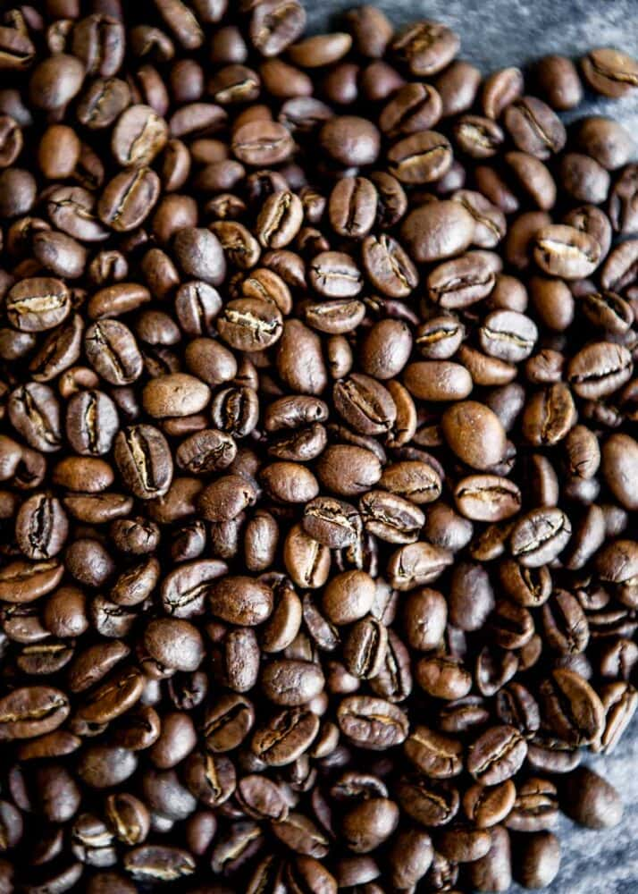 photo of whole, roasted coffee beans ready for a healthy coffee recipe