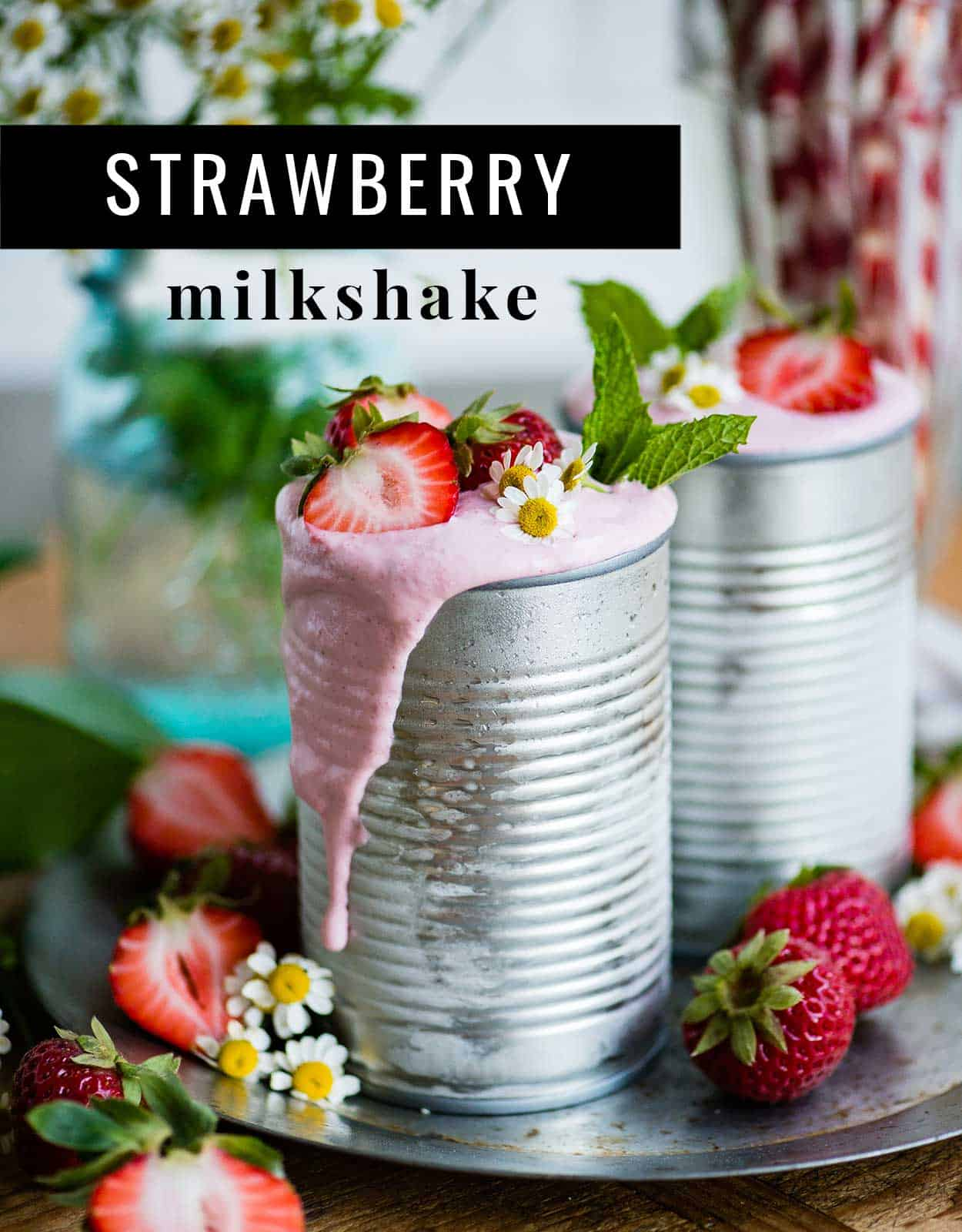 Strawberry milkshake using a nut-based milk in tin cans