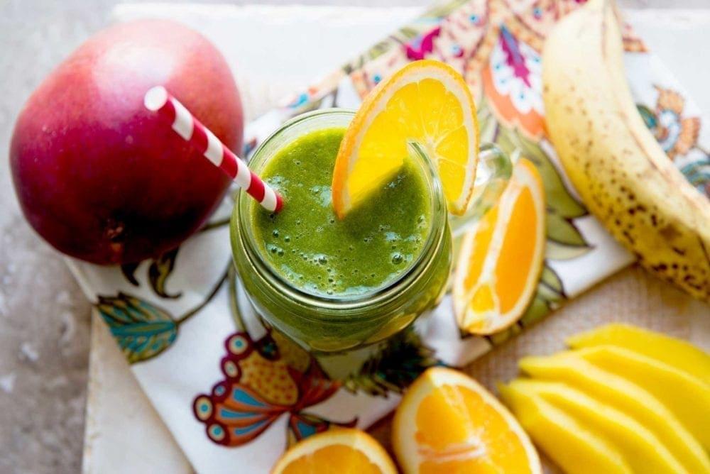 Ingredients for a green mango orange smoothie