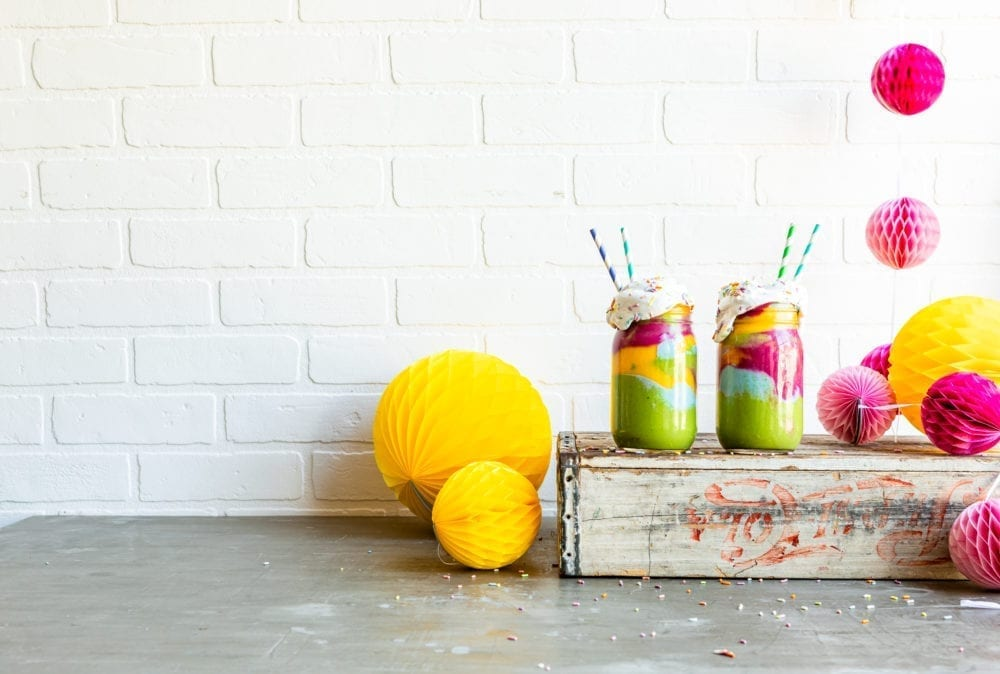 Cute paper straws in a healthy smoothie recipe that's tie dye style.