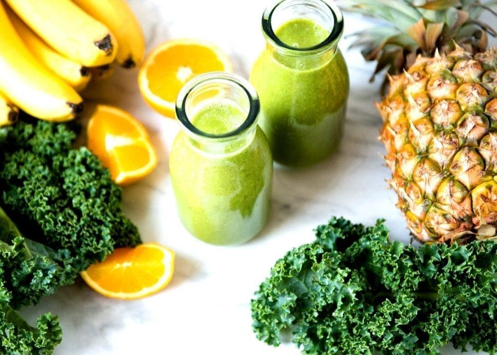 Coconut water smoothie using kale, oranges and banana.