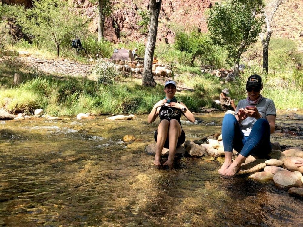 Cooling our feet in the water during Grand Canyon hike