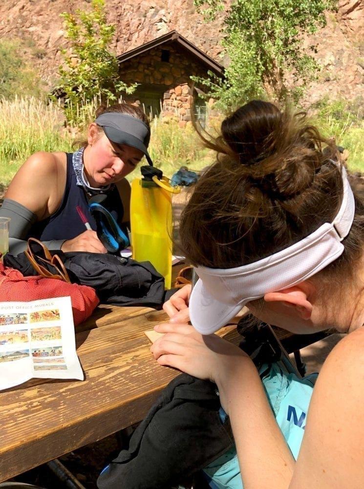 Writing home during Grand Canyon rim to rim hike