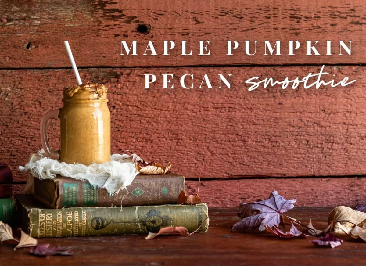health benefits of a pumpkin smoothie sitting on top of old books with red wood background