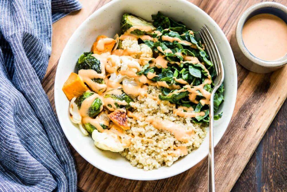 Happy veggie bowl with quinoa, green veggies and sweet potato