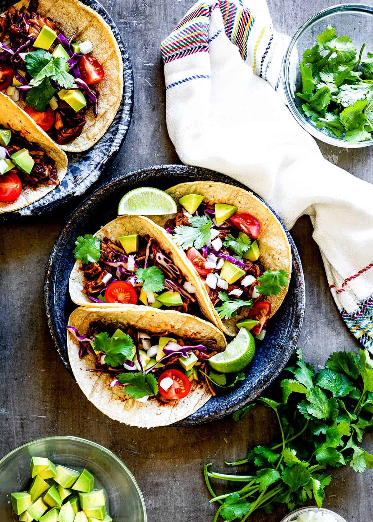 Meatless BBQ Jackfruit Tacos topped with an array of delicious toppings.