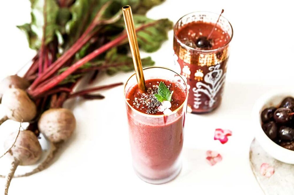 gold rimmed jar with beet smoothie