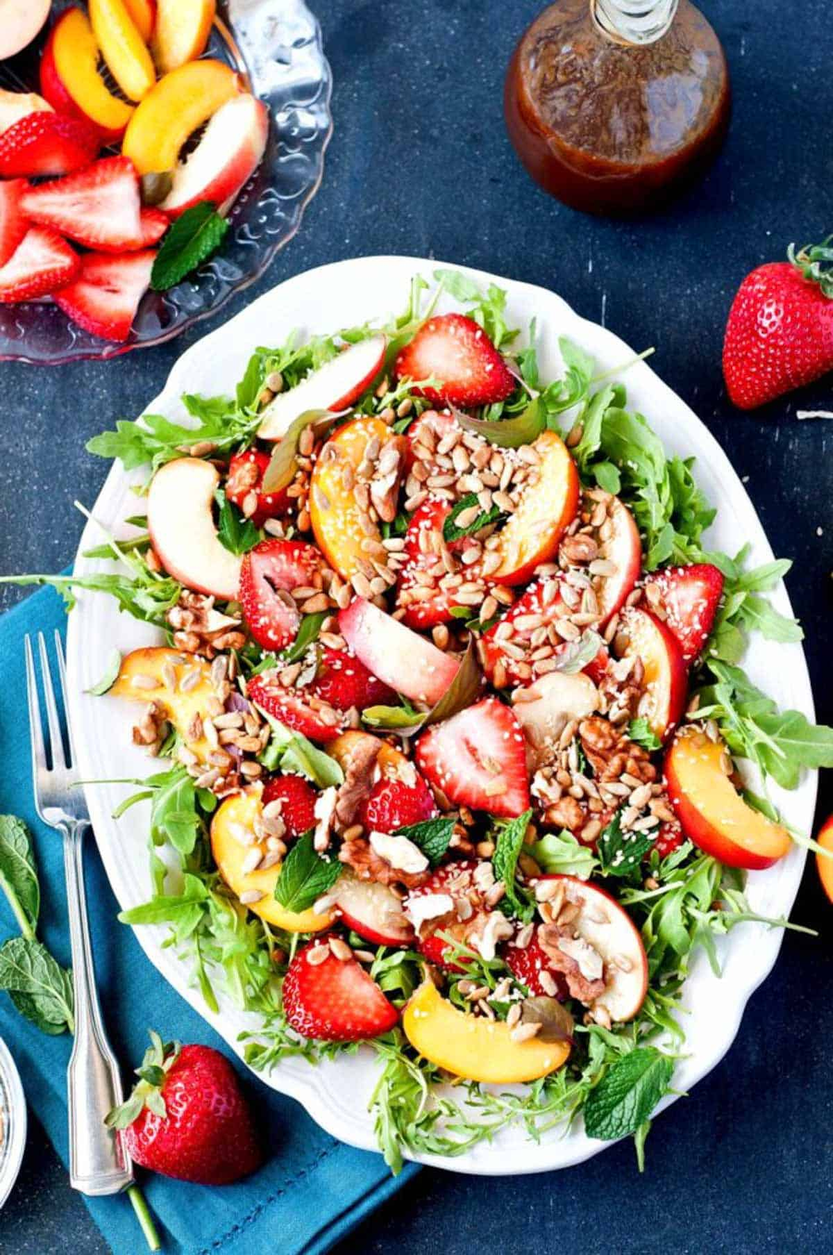 This mixed green salad is the perfect display of spring fruits