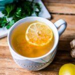fresh teacup of the best detox tea with sliced lemon