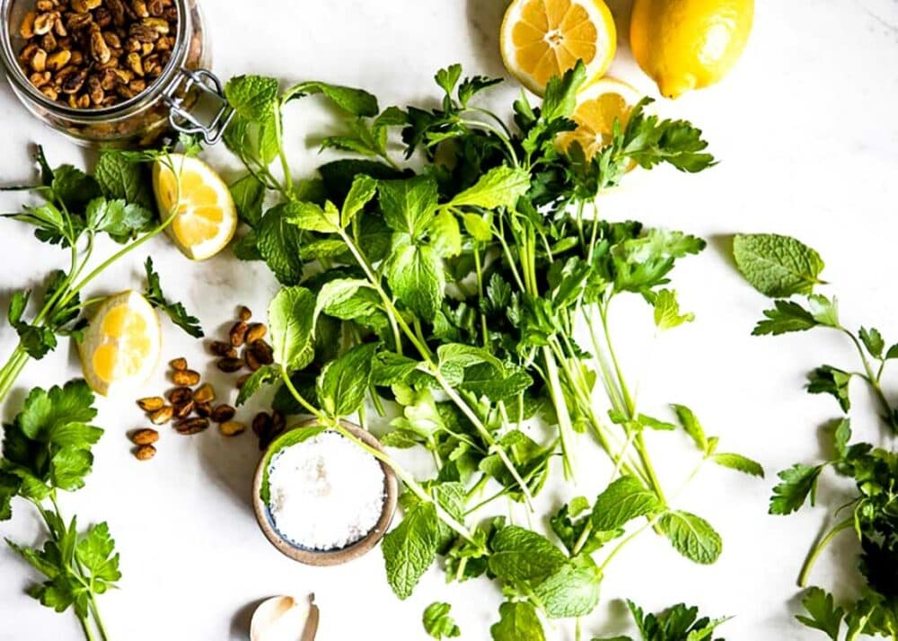 fresh mint leaves and sea salt for vegan pesto recipe