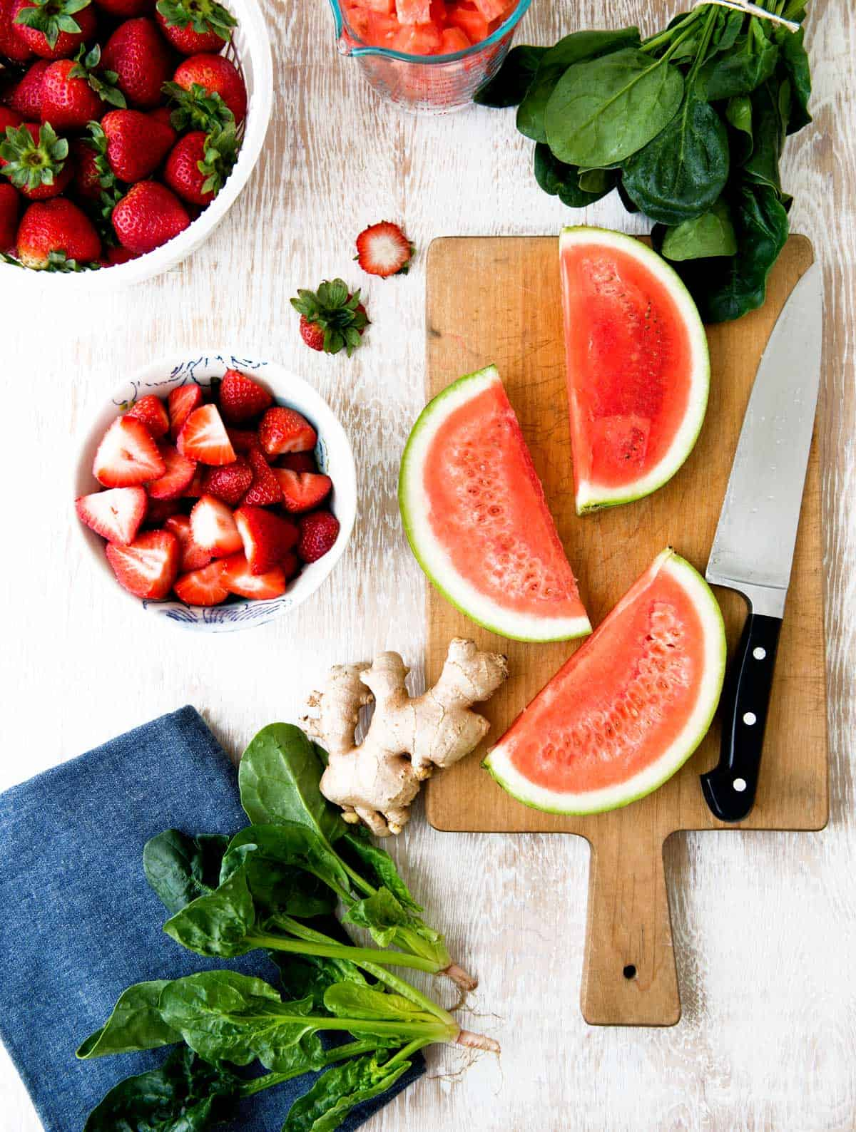 Ingredients for watermelon and strawberry green smoothie