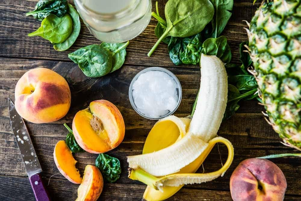 Peaches, bananas and coconut oil are special ingredients in a pre workout smoothie
