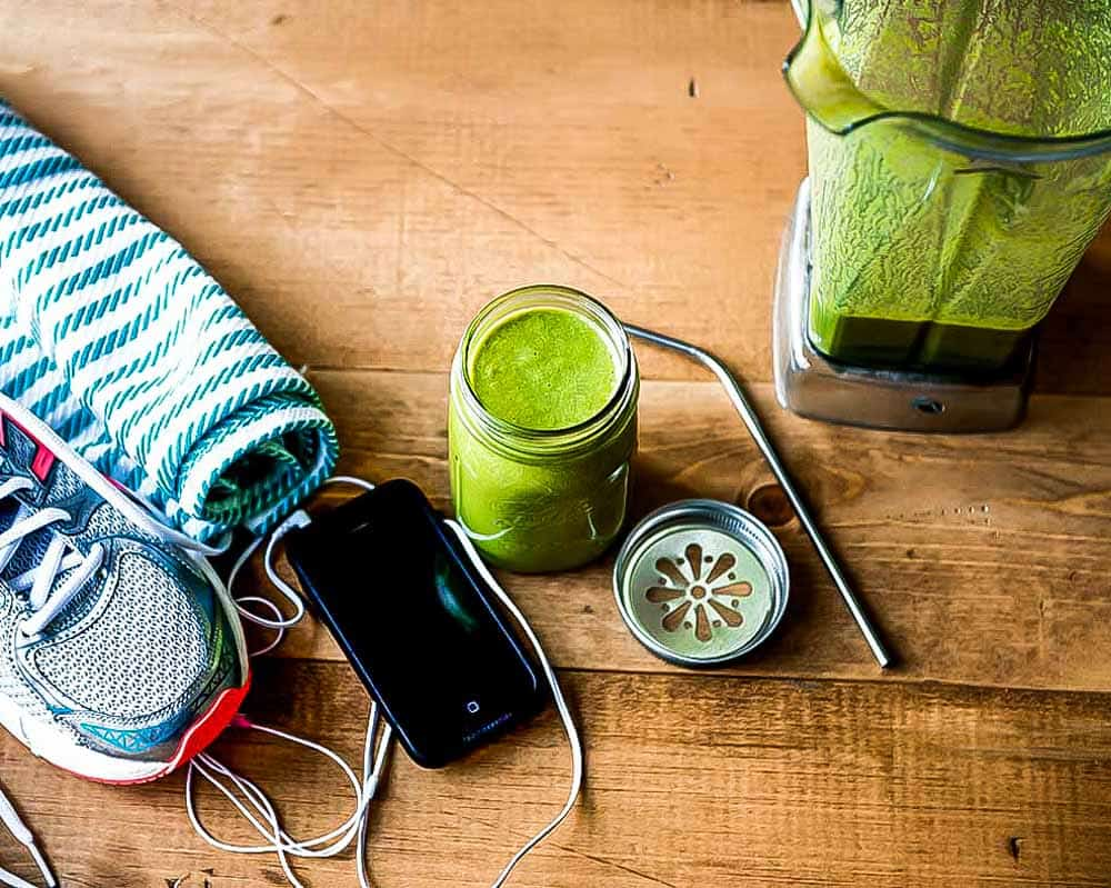 Shoes, phone and green smoothie ready for a workout