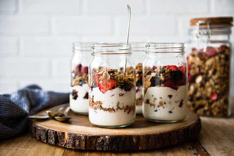3 Vegan Yogurt Parfaits in mason jars