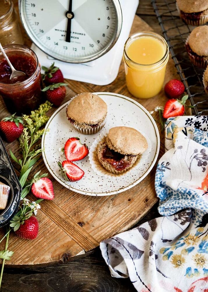 Breakfast table with vegan muffins and fresh strawberry jam.