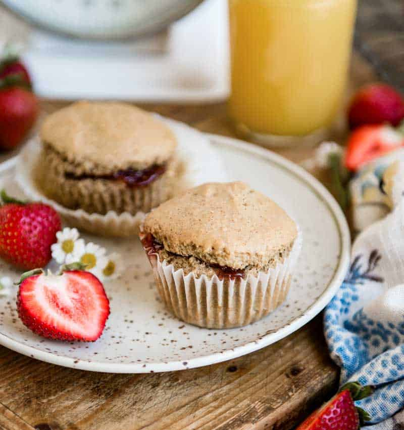 plate with strawberry vegan muffins and fresh fruit