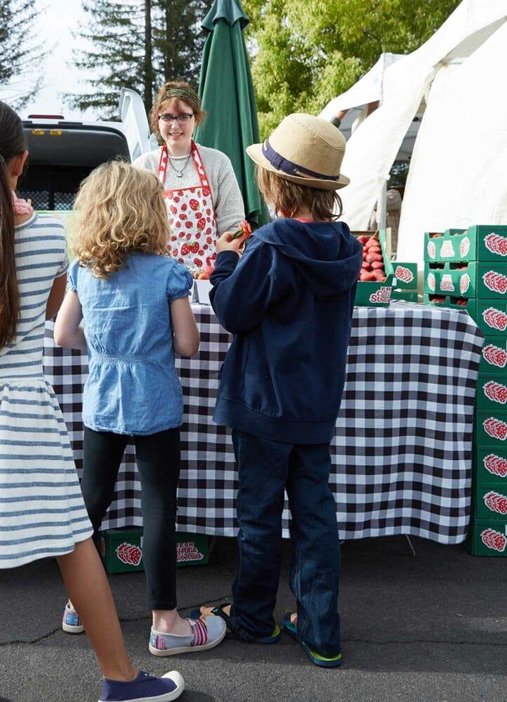 Shopping at farmers market with my kids to create healthy smoothies for kids