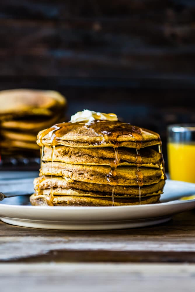 an up close shot of beautifully stacked pumpkin pancakes