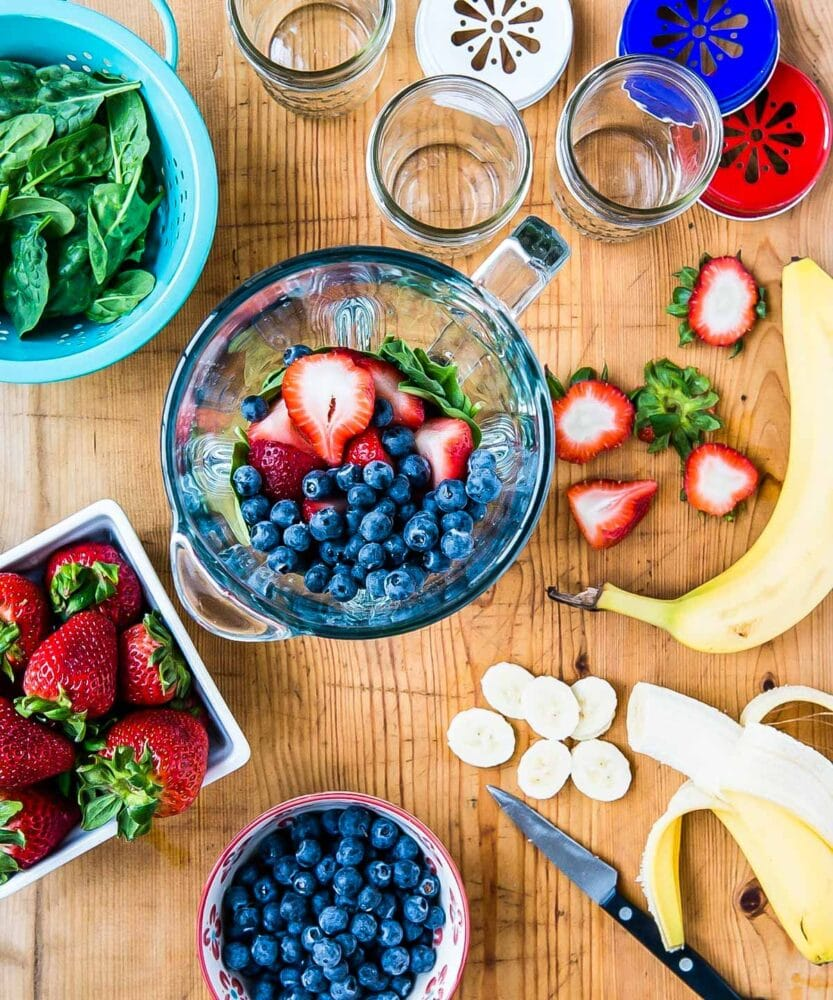 Bananas, blueberries and spinach in blender