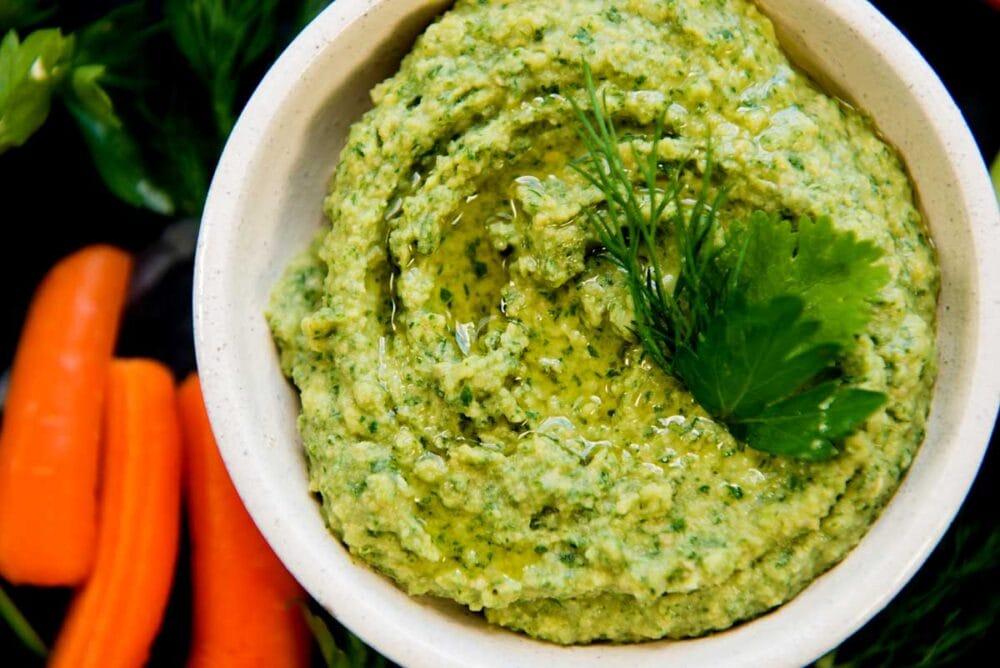 Homemade hummus with herbs
