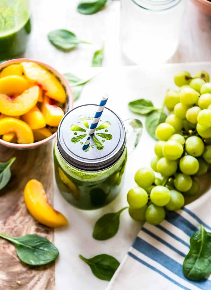 Ingredients for green smoothie with grapes and peaches