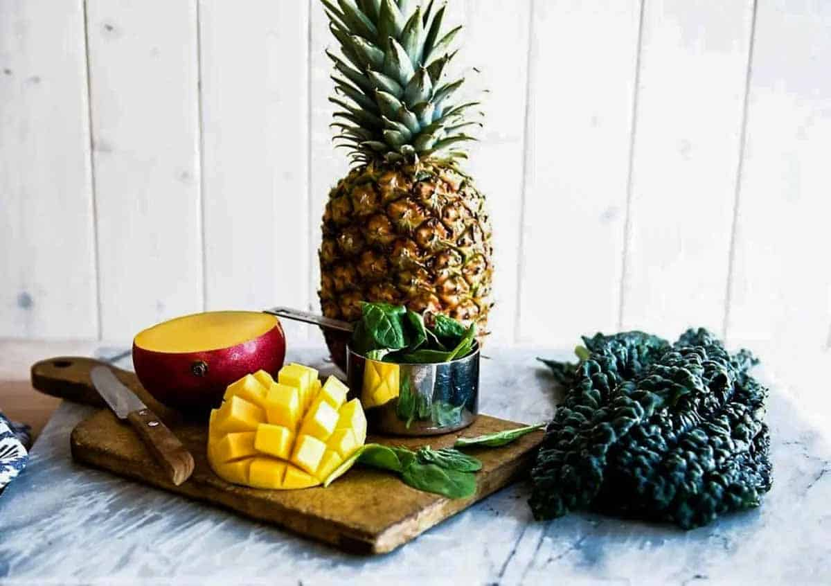 Fresh pineapple and mango for detox green smoothie