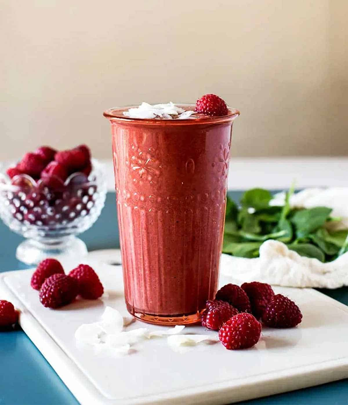 Raspberry smoothie topped with coconut